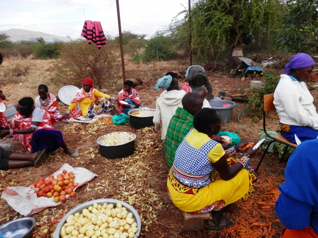 The mothers preparing food for the ceremony.