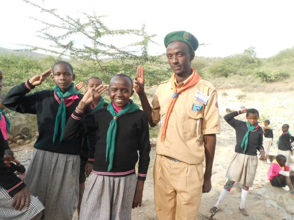 Scout leader with the school children