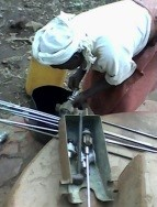 The women caretaker being trained in how to replace pump seals.