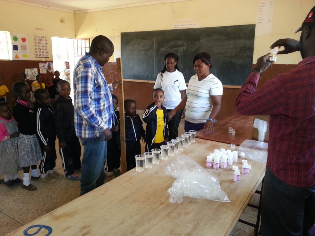 Children lining up to take their Trachoma medicine