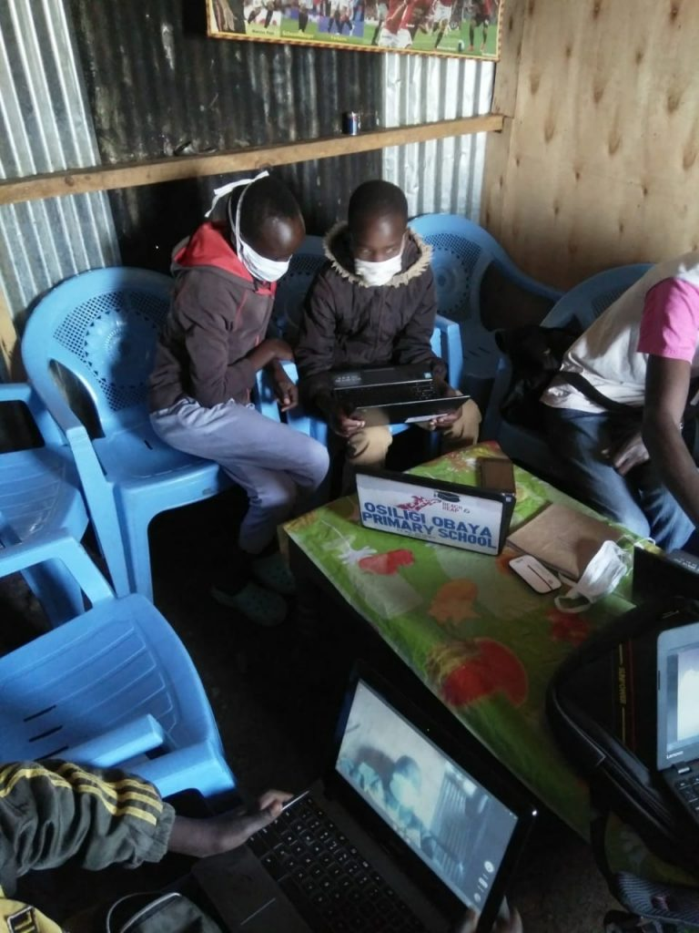 Children learning in their huts